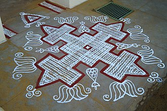 Kolam - Traditional kolam made with rice flour and kaavi borders for a house function at Tamil Nadu, India