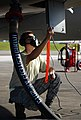 U.S. Air Force Senior Airman Nathen Valentin, an aircraft fuels system journeyman with the 18th Component Maintenance Squadron, oversees the refueling of an F-15 Eagle aircraft Aug. 27, 2013, at Andersen Air 130827-F-NA975-032.jpg