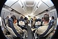 U.S. Army Spc. Krissimay Castro, left, with Delta Company, 1st Battalion, 294th Infantry Regiment, Guam Army National Guard, waits with other passengers aboard a flight from Kandahar Airfield, Afghanistan, to 131029-Z-WM549-005.jpg