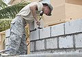 U.S. Army Spc. Zach Metz, an engineer with the 1023rd Vertical Engineer Company, 528th Engineer Battalion, Louisiana Army National Guard, lays blocks April 16, 2014, at Stella Maris School and the Belize Academy 140416-F-EE220-121.jpg