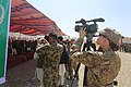 U.S. Army Staff Sgt. Jacqueline Fitzgerald, right, a noncommissioned officer in charge of public affairs with a tactical advisory command, takes video of the opening ceremony of the Afghan National Army 1st 130820-A-NQ567-084.jpg