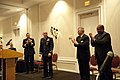 U.S. Coast Guard Chief Warrant Officer Mario Vittone, center, stands at attention during his retirement ceremony in Portsmouth, Va., Jan. 11, 2013 130111-G-VS714-334.jpg