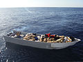 U.S. Coast Guardsmen assigned to the coastal patrol boat USCGC Haddock (WPB 87347) count bales of marijuana aboard a seized panga in the Pacific Ocean off the coast of southern California March 17, 2014, as part 140317-G-ZZ999-002.jpg