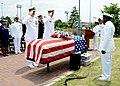 U.S. Navy Rear Adm. Matthew J. Carter, center left, the commander of Fleet Air Forward, and Capt. Steven Wieman, center right, the commanding officer of Naval Air Facility (NAF) Atsugi, salute after laying 130527-N-OX321-137.jpg