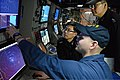 U.S. Navy Sonar Technician (Surface) 1st Class Andrew Murphy, front, works with South Korean sailors in the sonar control room of the guided missile destroyer USS McCampbell (DDG 85) during an antisubmarine 130316-N-TG831-240.jpg