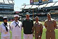 U.S. Sailors pose for a photograph with Oakland Athletics baseball team relief pitcher Brad Ziegler, center, as part of Operation Care and Comfort in Oakland, Calif., July 4, 2011 110704-N-ZZ999-002.jpg