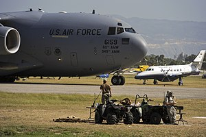 USAF Combat Control Team at Toussaint L'Ouverture Airport with C-17.jpg