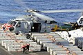 USS John C. Stennis offloads ordnance. (8661310506).jpg