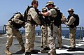 US Navy 040401-N-9885M-002 Members assigned to the Visit Board Search and Seizure (VBSS) team aboard the guided missile destroyer USS McFaul (DDG 74) don their equipment after getting orders to conduct a search of a fishing dho.jpg