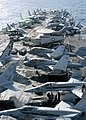 US Navy 040701-N-7408M-023 Aircraft assigned to Carrier Air Wing One (CVW-1) blanket the flight deck of nuclear-powered aircraft carrier USS Enterprise (CVN 65), during a replenishment at sea with the fast combat support ship U.jpg