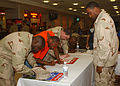 US Navy 040812-N-1825E-044 Legalman 1st Class Greg J. Dorsey helps Sailors registering to vote at the Desert Dome Food Court.jpg
