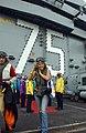 US Navy 041215-N-5345W-016 Television personality and model Leann Tweedan departs the Nimitz-class aircraft carrier USS Harry S. Truman (CVN 75).jpg