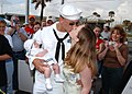 US Navy 050408-N-0874H-001 Fire Controlman 2nd Class Drew Pickens embraces his new son with wife for the first time after returning from deployment.jpg