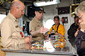 US Navy 050430-N-7711S-055 Commanding Officer, USS Ronald Reagan (CVN 76), Capt. James Symonds, center, explains the purpose of the Ouija Board, to members of the Joint Civilian Orientation Conference (JCOC).jpg
