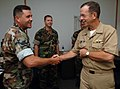 US Navy 060829-N-5758H-022 Chief of Naval Operations (CNO) Adm. Mike Mullen greets Senior Chief Boatswain's Mate Kevin P. Sherwood during a visit to Riverine Group One (RIVRON-1) and Riverine Squadron One at Naval Amphibious Ba.jpg