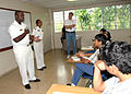 US Navy 070502-N-9486C-001 Hospital Corpsman 1st Class Charles Givens, Commander Task Group 40.9 Independent Duty Corpsman, explains his military decorations to the students at Colegio International Del Caribe international sch.jpg