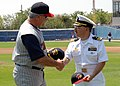 US Navy 070719-N-8655E-002 Cmdr. Howard Goldman, commanding officer of USS Toledo (SSN 769), exchanges ball caps with Mike Rojas, manager of the Toledo Mud Hens minor league baseball team, during a game against the Norfolk Tide.jpg
