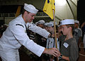 US Navy 070723-N-5215E-002 Mass Communication Specialist 3rd Class Christopher Lussier shows a young boy how to salute during the U.S. Naval Academy Visitors Center's.jpg