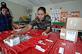 US Navy 070815-N-0194K-157 Air Force Staff Sgt. Claudia Hunter, a laboratory technician attached to Military Sealift Command hospital ship USNS Comfort (T-AH 20), unloads medical equipment to be used at a medical site.jpg