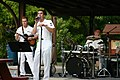 "US Navy 070828-N-7163S-008 (From left) Musician 3rd Class Joe Gacioch, Musician 3rd Class Justin Glenn, and Musician 2nd Class Ted Moore of Navy Band Great Lakes' rock band ""Horizon"" perform rock standards at.jpg"