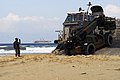 US Navy 071111-N-0120A-158 Seaman Chris Smith, assigned to Beach Master Unit (BMU) 1, directs the loading of Marine equipment and supplies onto Landing Craft Air Cushion (LCAC) 90 on the beach.jpg