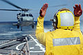 US Navy 071227-N-4014G-010 Boatswain's Mate 3rd Class Emanuel Williams directs an MH-60S Seahawk assigned to the.jpg