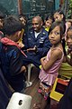 US Navy 081028-N-5253W-093 Aviation Boatswain's Mate (Handling) 1st Class David Clora plays with students of the New Cabalan Elementary School.jpg