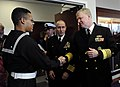 US Navy 081107-N-8273J-267 Chief of Naval Operations (CNO) Adm. Gary Roughead congratulates Sailors at the conclusion of the graduation ceremony for 956 Sailors at the Recruit Training Command.jpg