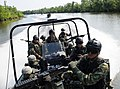 US Navy 090630-N-8933S-010 Students from the Patrol Craft Officer course at the Naval Small Craft Instruction and Technical Training School extract students from the Western Hemisphere Institute for Security Cooperation.jpg