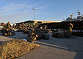 US Navy 100115-N-1831S-054 Marines organize their gear to take aboard USS Bataan (LHD 5).jpg