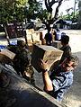 US Navy 100127-N-7948C-032 Hospital Corpsman 1st Class Matthew Evans loads humanitarian aid boxes onto a U.N. truck at Killick Haitian Coast Guard Base.jpg
