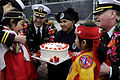 US Navy 100305-N-7478G-340 Chon Yea Un, daughter of a Republic of Korea naval officer takes a taste of the cake that was presented to her and Jeon Ye Som.jpg