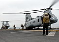 US Navy 100603-N-0515W-011 Aviation Boatswain's Mate 3rd Class Brandt Krauel directs Marines as they embark a CH-46E Sea Knight aboard the amphibious assault ship USS Bonhomme Richard (LHD 6) during Dawn Blitz 2010.jpg
