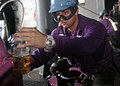 US Navy 100630-N-2013O-088 Aviation Boatswain's Mate (Fuel) Airman Victor Hopkins, from Glen Burnie, Md., collects a sample of JP-5 jet fuel for analysis aboard the aircraft carrier USS George Washington (CVN 73).jpg
