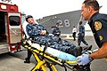 US Navy 110223-N-YR391-003 Naval Station Mayport fire fighters evacuate injured personnel during a simulated mass casualty drill aboard the guided.jpg