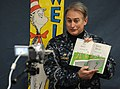 US Navy 110301-N-2858S-006 Capt. Eric Gardner, commanding officer of Naval Air Facility Atsugi, makes a recording of Dr. Seuss'.jpg
