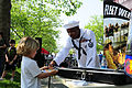 US Navy 110528-N-YM084-065 Aviation Boatswain's Mate (Fuel) 1st Class Colin Louis talks to a boy about the U.S Navy during the Fleet Week Air and G.jpg