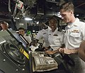 US Navy 110906-N-TB118-118 Junior officers aboard (PCU) Spruance (DDG 111) look through a photo album of the ship's namesake, Adm. Raymond Spruance.jpg