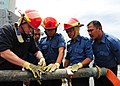 US Navy 111003-N-ED900-262 Damage Controlman 1st Class Aaron Hoke practices pipe patching with Royal Brunei Navy sailors.jpg