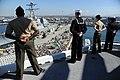 US Navy 111114-N-UE944-102 Sailors and Marines man the rails aboard the amphibious assault ship USS Makin Island (LHD 8) as the ship departs San Di.jpg