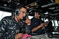 US Navy 111116-N-YX169-309 A Sailor calls in a report over a sound-powered telephone.jpg