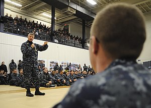 US Navy 120119-N-ED149-120 Master Chief Petty Officer of the Navy (MCPON) Rick D. West talks with Sailors stationed aboard the aircraft carrier USS.jpg
