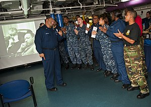 US Navy 120123-N-FI736-165 Sailors sing hymns during a Dr. Martin Luther King, Jr. birthday celebration aboard the aircraft carrier USS Enterprise.jpg