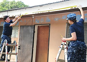 US Navy 120129-N-ET019-780 Sailors take measurements for a home refurbishment project.jpg