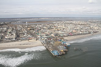 Star Jet - Aerial view of damage to Casino Pier following Hurricane Sandy. Star Jet is at lower right.