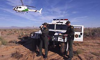 United States Border Patrol - Border Patrol Agents with a Hummer and Astar patrol for illegal entry into the United States
