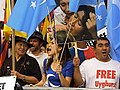 Uyghur People Demand Freedom with Flag of East Turkestan in front of the U.N. Building in NYC 維吾爾人在紐約聯合國大樓外高舉東突厥斯坦國旗要求自由.jpg