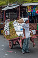 Vendor carrying their products to prepare.jpg