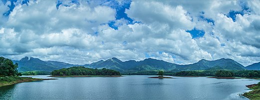A panoramic view of Western Ghats mountain ranges from Mangalam Dam Reservoir