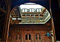 View of Courtyard and wall through an open window - Sethi House Complex.jpg